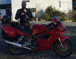 Jon Holmes Business Development Manager at Swathe Services on his motorbike